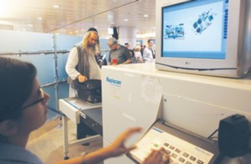 baggage screening_311 (photo credit: (Nir Elias/Reuters))