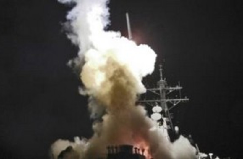 Tomahawk missile being fired from USS Barry 311 (R) (photo credit: REUTERS/Roderick Eubanks/US Navy photo)