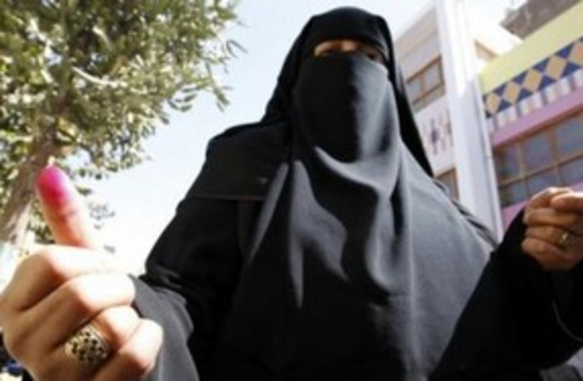 Woman shows inked finger after voting in Egypt 311 (R) (photo credit: REUTERS/Amr Abdallah Dalsh)