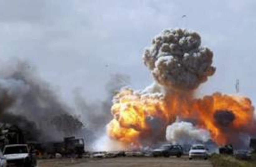 Air strike on Libyan government forces 311 (R) (photo credit: REUTERS/Goran Tomasevic)