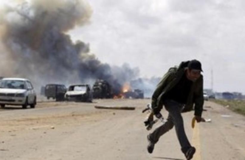 Libya bombing 311 (photo credit: REUTERS/Goran Tomasevic)
