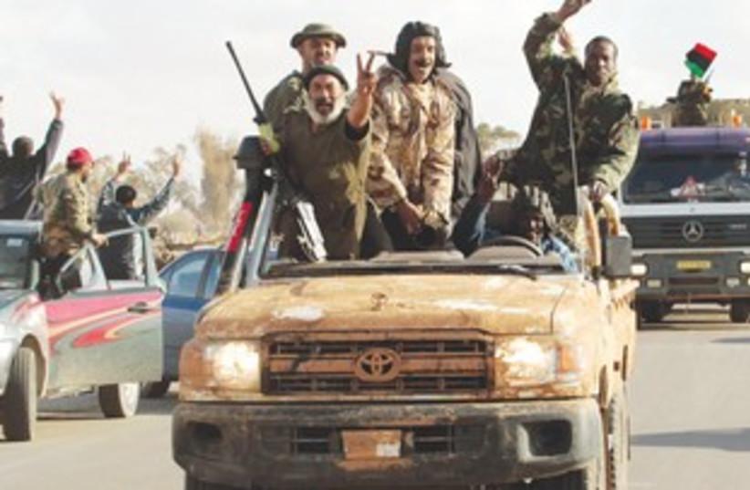 Libya rebels celebrate 311 (photo credit: Suhaib Salem/Reuters)