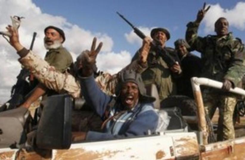 Libyan rebels celebrate 311 (R) (photo credit: REUTERS/Suhaib Salem)