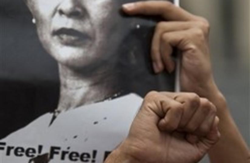 Myanmar student demonstrators hold photographs of  (photo credit: AP)