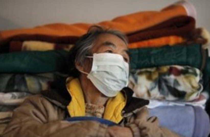 japan earthquake victim 311 (photo credit: REUTERS/Carlos Barria )