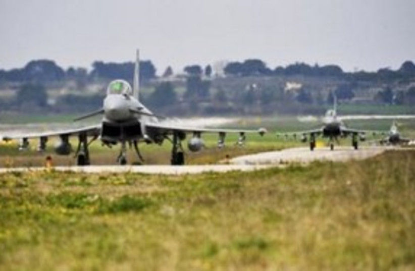 British Royal Air Force (RAF) Typhoon fighter jet 311 (R) (photo credit: REUTERS/SAC Neil Chapman)