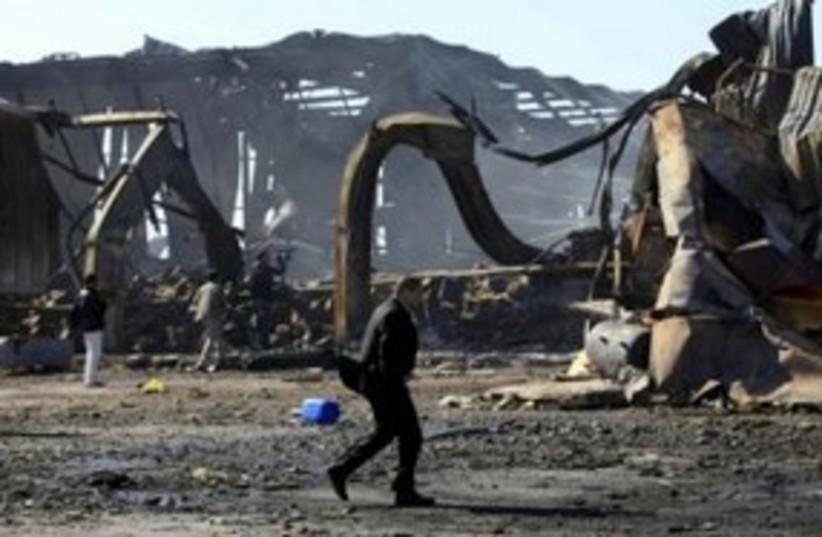 Libyanat naval facility damaged by air strikes 311 R (photo credit: REUTERS/Ahmed Jadallah)