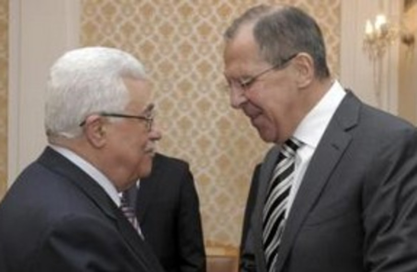PA President Abbas with Russian FM Sergei Lavrov 311 (R) (photo credit: REUTERS/Pool)