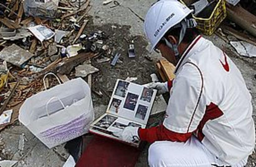 japan rubble sad 311 (photo credit: REUTERS)
