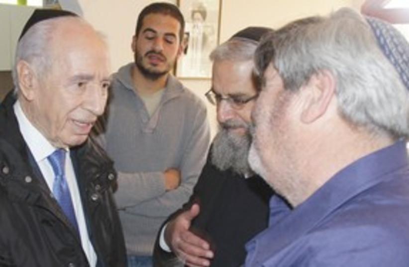 Peres at the Fogels 311 (photo credit: Yosef Avi Yair Engel)