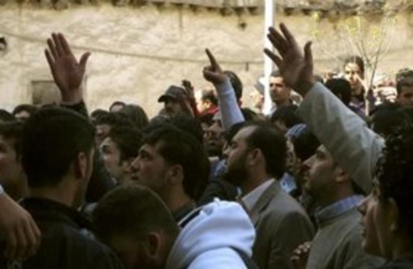 Syrians shout slogans in protests 311 (photo credit: REUTERS/Stringer )