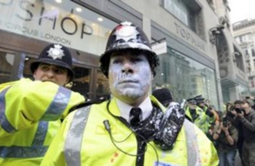 London policeman with paint on face (photo credit: REUTERS/Paul Hackett )