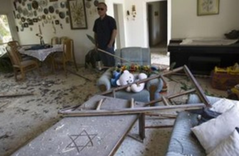 Rocket damage in house 311 (photo credit: REUTERS/Amir Cohen)
