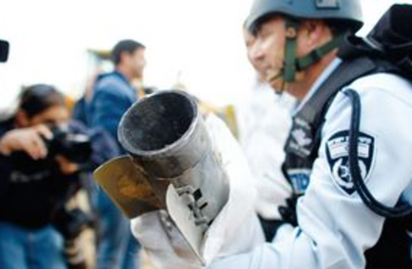 Grad rocket with police (photo credit: Reuters)