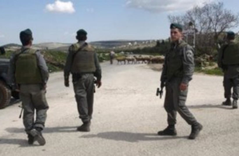 Border Police officers in the West Bank town Awarta 311 (R) (photo credit: REUTERS/Abed Omar Qusini)
