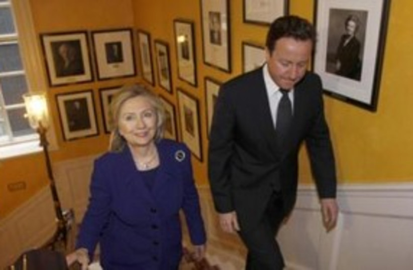 US Secretary of State Clinton with UK PM Cameron 311 (R) (photo credit: REUTERS/Suzanne Plunkett)