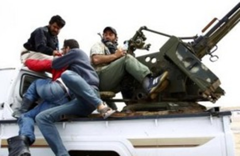 Libyan rebels with anti-aircraft gun 311 (R) (photo credit: REUTERS/Andrew Winning)