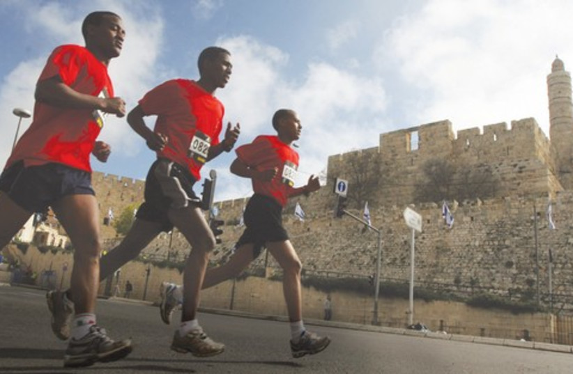 Runners in the Jerusalem Marathon 521 (photo credit: Marc Israel Sellem)