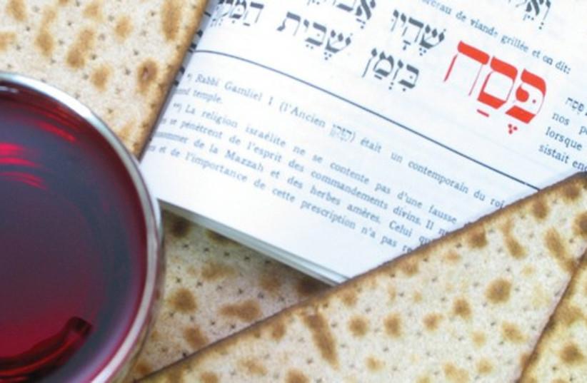 Haggadah  and Matzah 521 (photo credit: Marc Israel Sellem)