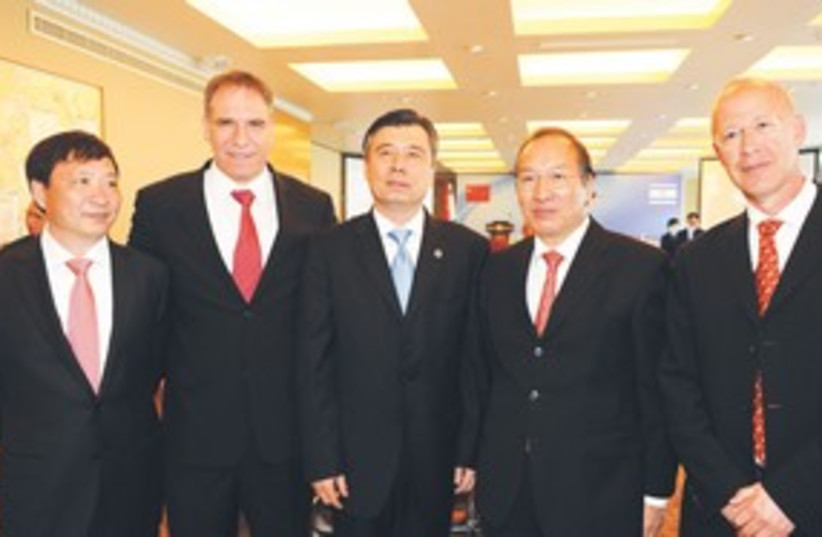 INFINITY GROUP managing partners 311 (photo credit: Koby Koenkas)