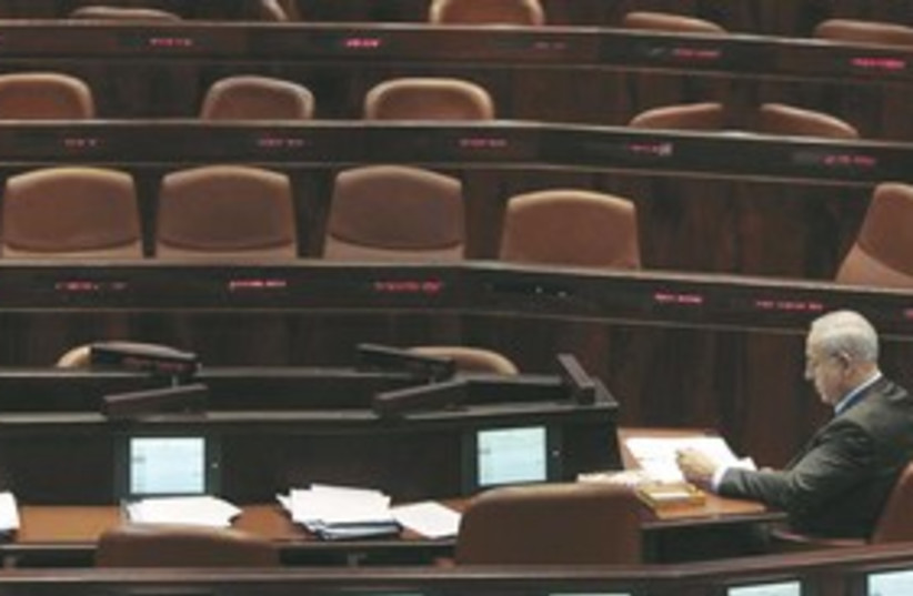 Netanyahu in Knesset alone 311 (photo credit: REUTERS)