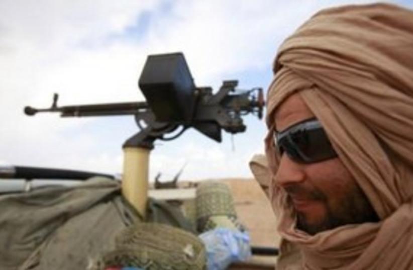 Libya rebel 311 Reuters (photo credit: REUTERS/Andrew Winning)