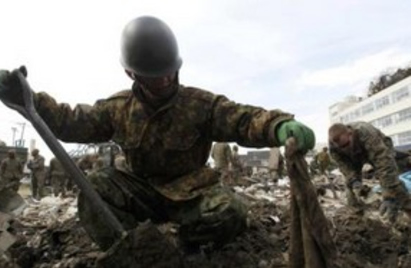 Japanese soldier searches for bodies 311 (R) (photo credit: REUTERS/Kim Kyung-Hoon)