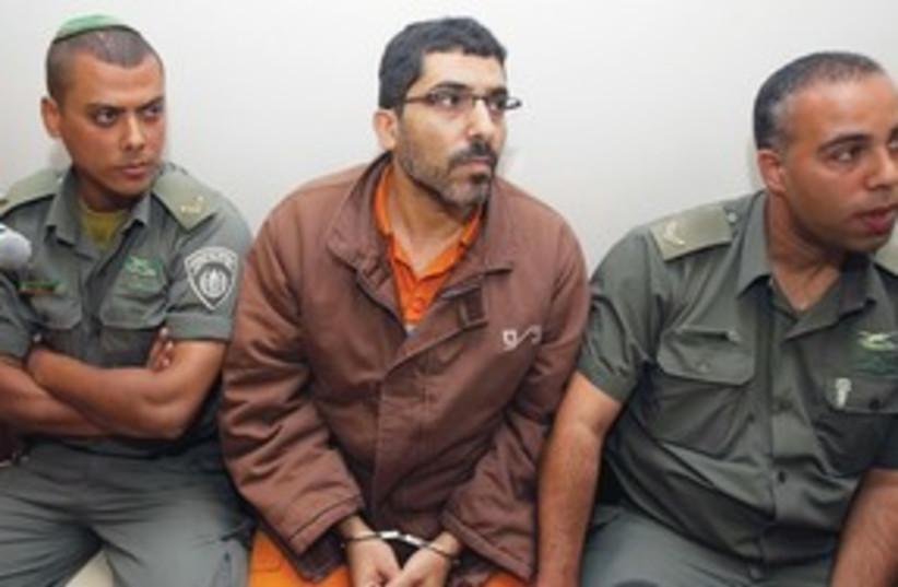 Palestinian engineer Dirar Abu Sis in court 311 (R) (photo credit: Baz Ratner/Reuters)