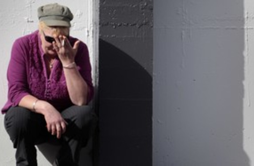 Stress worried smoking cigarette 311 (R) (photo credit: TIM WIMBORNE / Reuters)