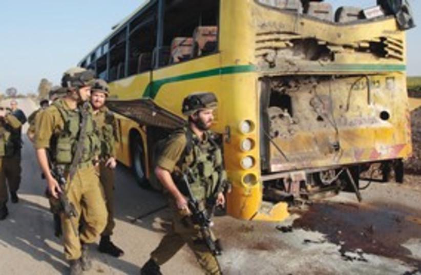 School bus anti tank attack 311 (photo credit: Baz Ratner/Reuters)