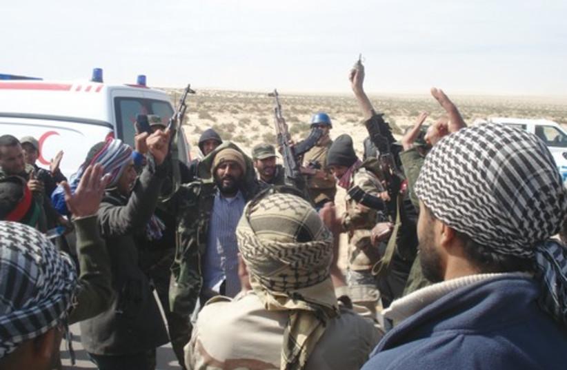 Libyan rebels celebrating 521 (photo credit: Steven Sotloff)