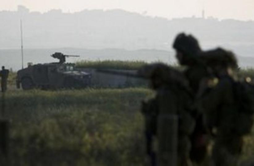 IDF soldiers near Gaza border 311 (R) (photo credit: REUTERS/Amir Cohen)