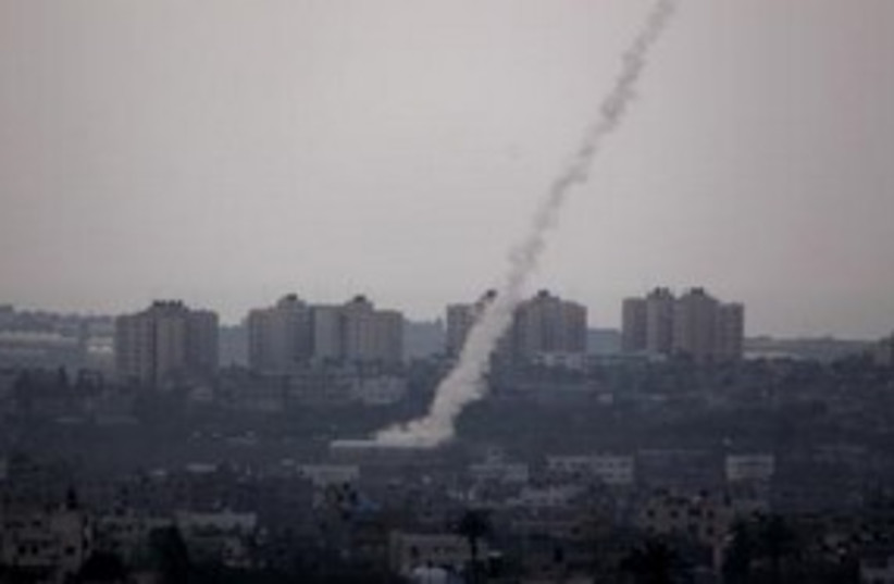 Kassam rocket being fired from Gaza Strip 311 (R) (photo credit: REUTERS/Darren Whiteside)