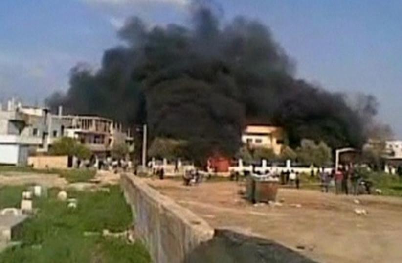 Syria Deraa burning building 520 (photo credit: REUTERS/Reuters TV)