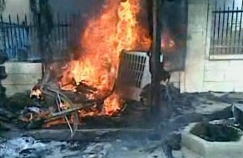 Syria Deraa fire 520 (photo credit: REUTERS/Reuters TV)