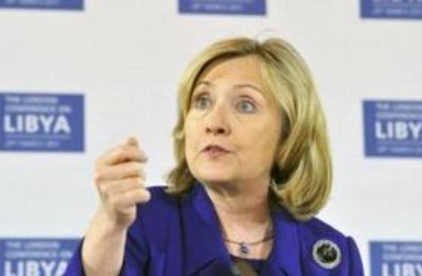 Hilary Clinton Libya background 311 (photo credit: REUTERS/Toby Melville)