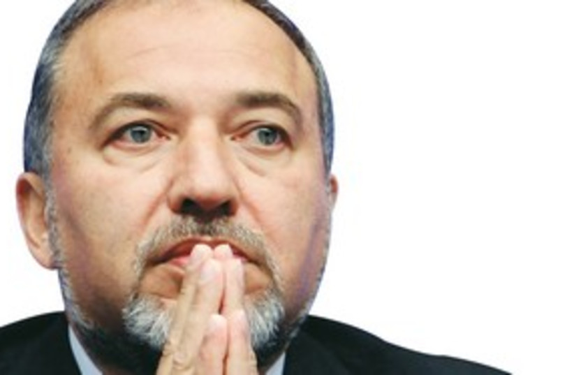 Avigdor Lieberman looks sad, crying? 311 (R) (photo credit: Reuters)