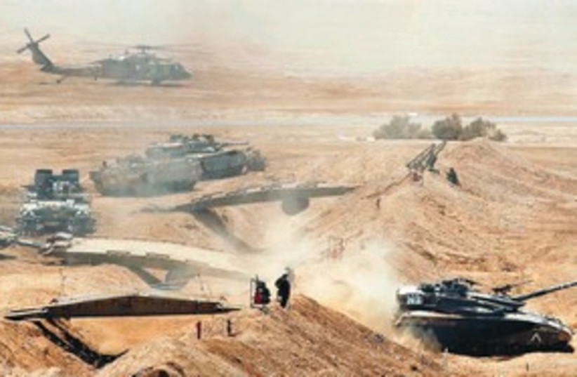 An IDF exercise in the South tanks helicopters  311 (R) (photo credit: Reuters)