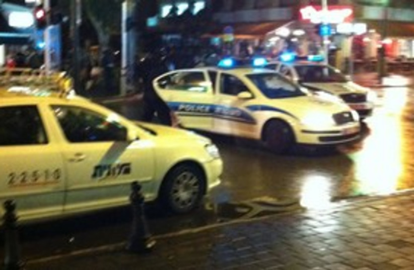Police car and taxi in Tel Aviv at night 311 (photo credit: Yoni Cohen)