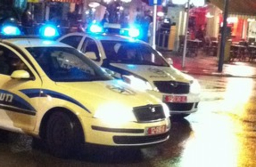 Police car in Tel Aviv at night 311 (photo credit: Yoni Cohen)