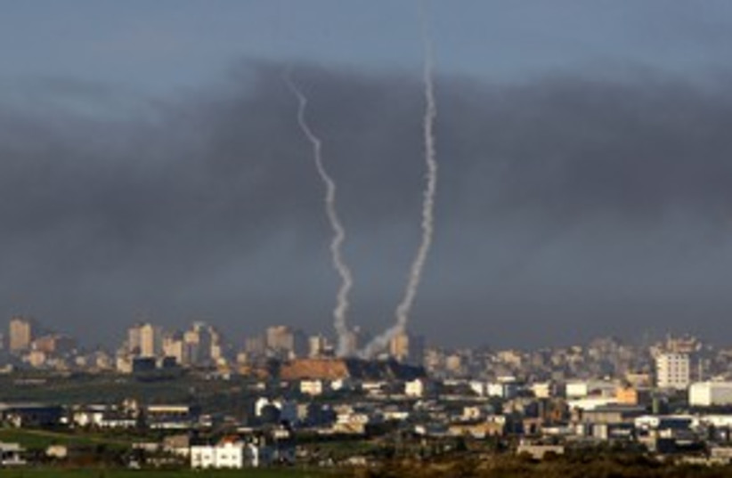 Smoke trails from rockets being fired in Gaza 311 (R) (photo credit: Yannis Behrakis / Reuters)