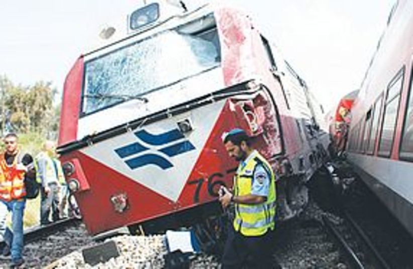 israel railways 311POLICE AND RESCUE workers survey the scen (photo credit: Nir Elias/Reuters)