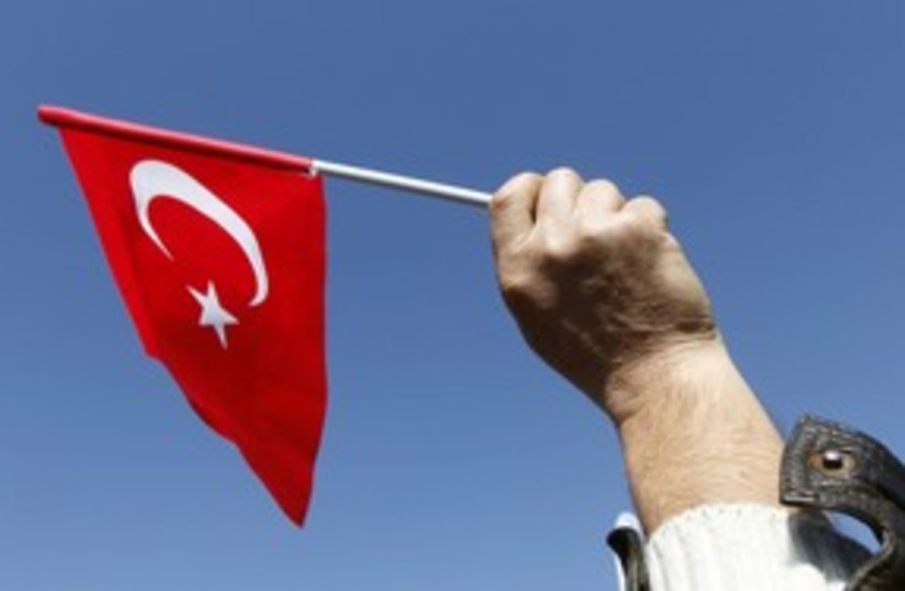 Turkish flag 311 (R) (photo credit: Osman Orsal / Reuters)