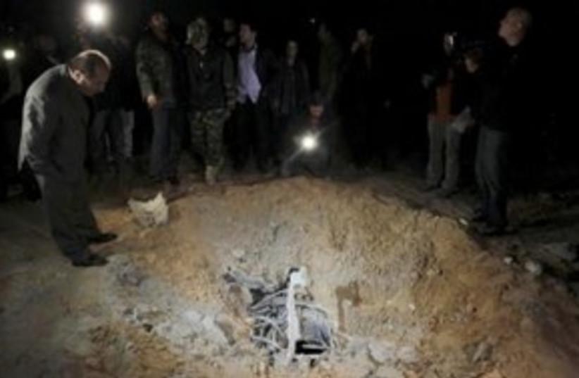 Libya airstrike crater 311 (photo credit: REUTERS)