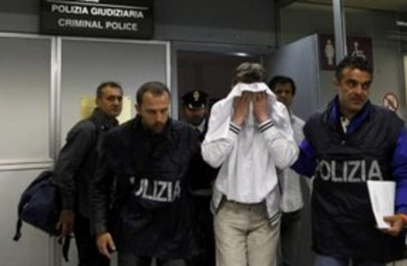 Would-be hijacker of Alitalia flight in police custody 311 R (photo credit: REUTERS/Alessandro Bianchi)