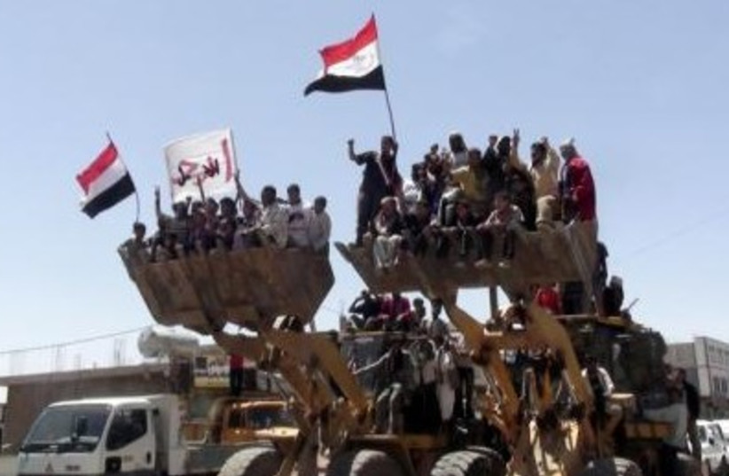 Yemen protests bulldozer 311 (photo credit: REUTERS)