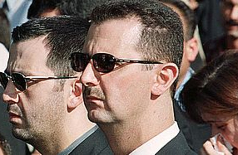 assad brothers 311 (photo credit: REUTERS)