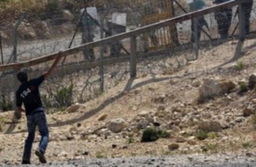 Bil'in demonstration 311 (R) (photo credit: Reuters)