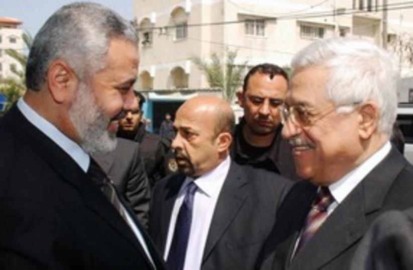 PA President Abbas with Hamas PM Ismail Haniyeh 311 (R) (photo credit: REUTERS/Abd Alhalim Abu Aska)