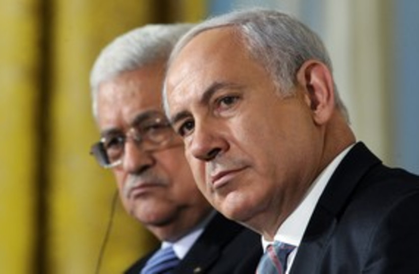 PA President Abbas with PM Netanyahu 311 (R) (photo credit: Jonathan Ernst / Reuters)